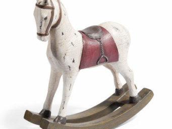 Le cheval à bascule : l'histoire d'un jouet d'antan