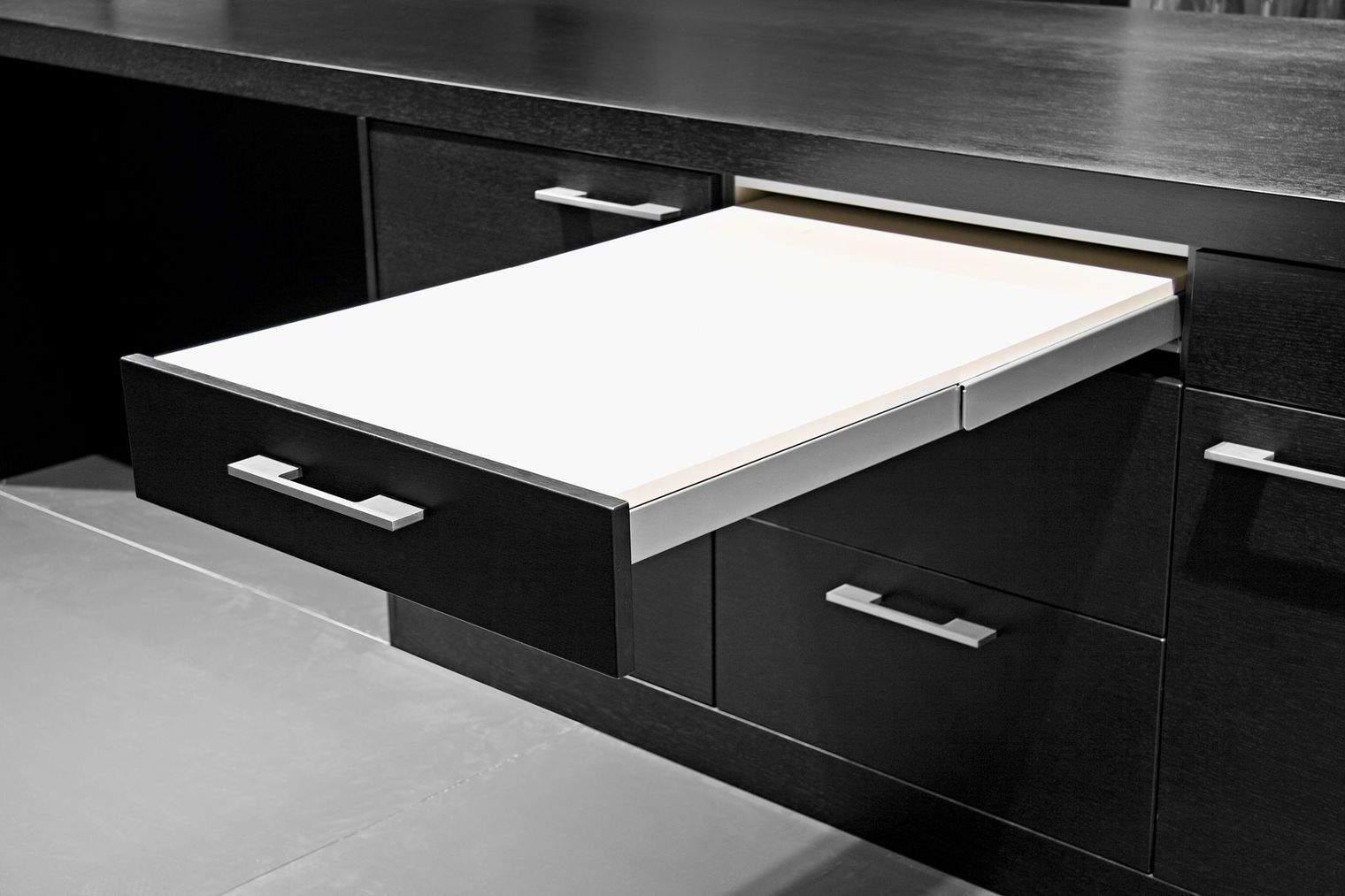 La cuisine une pi ce bien pens e - Table cuisine escamotable tiroir ...
