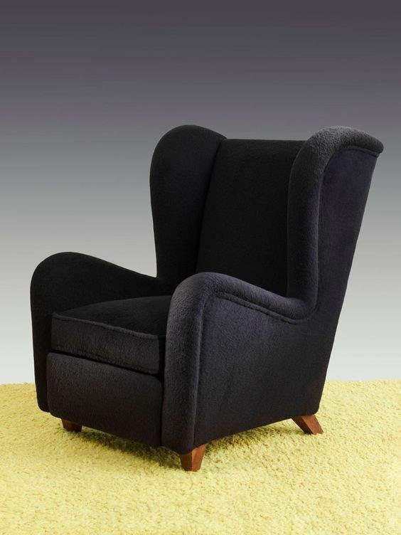 le fauteuil oreilles reste un intemporel dans la. Black Bedroom Furniture Sets. Home Design Ideas